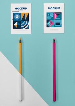 Maqueta de póster de vista superior y lápices