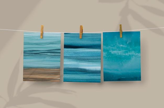 Maqueta de psd de foto de océano colgando de un clip de madera