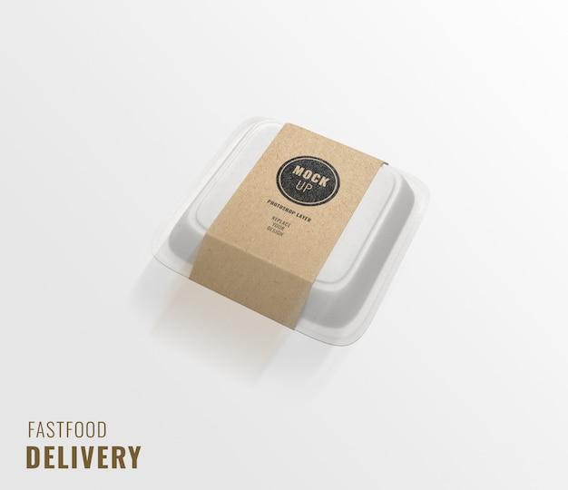 Maqueta de publicidad de entrega de caja de papel de comida rápida