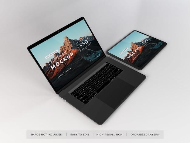Maqueta realista de computadora portátil y tableta
