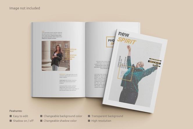 Maqueta de revista abierta con vista superior de portada