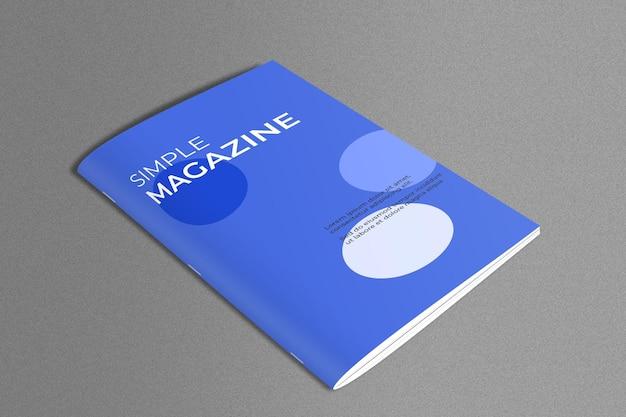 Maqueta de revista en superficie de mármol.