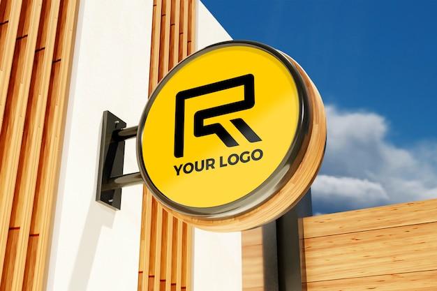 Maqueta de signo de logotipo en la tienda de oficinas del edificio exterior