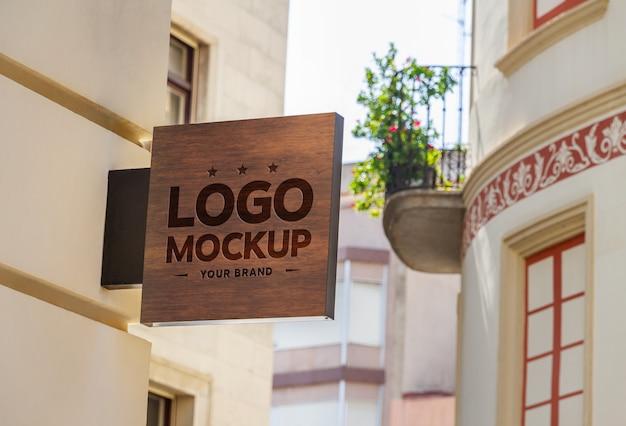 Maqueta de signo de marca de tienda grabada
