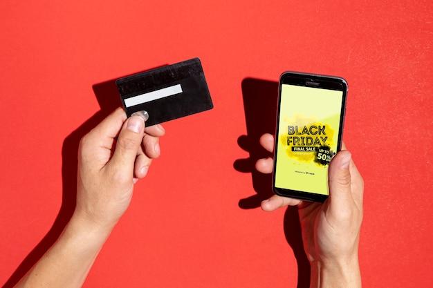Maqueta de smartphone con concepto de viernes negro