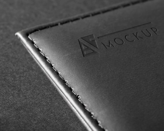 Maqueta de superficie de cuero negro con puntadas