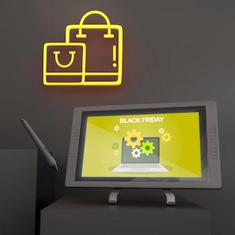 Maqueta de tableta gráfica con bolígrafo y luces de neón amarillas