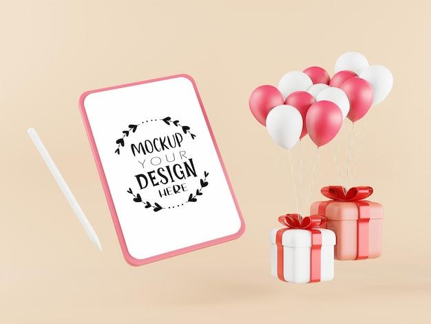 Maqueta de tableta de pantalla en blanco con cajas de regalo