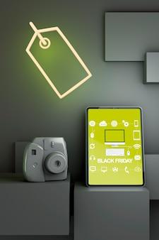 Maqueta de tableta viernes negro con luces de neón amarillas