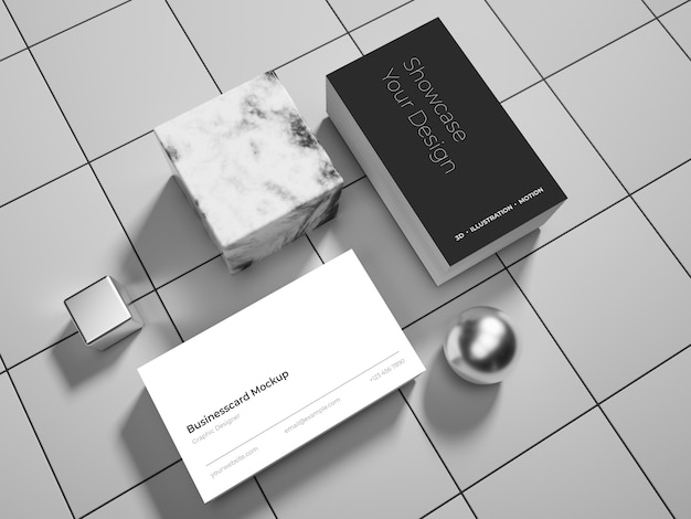 Maqueta de tarjeta de negocios sobre fondo gris azulejos con esferas brillantes y cubo