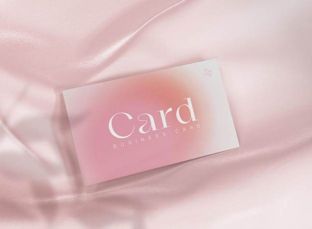 Maqueta de tarjeta de visita 3d sobre fondo de seda