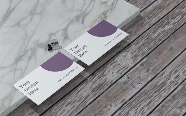 Maqueta de tarjeta de visita con clip de carpeta vista izquierda