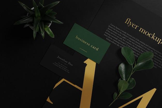 Maqueta de tarjeta de visita mínima limpia en papel a4 con hojas y fondo vegetal. archivo psd.
