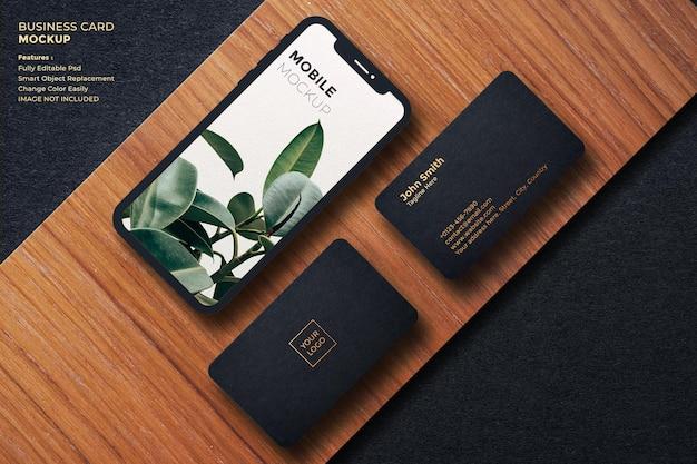 Maqueta de tarjeta de visita y móvil de lujo