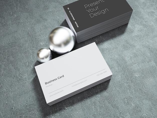 Maqueta de tarjeta de visita sobre fondo oscuro con esferas brillantes