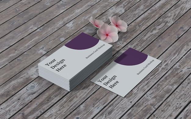 Maqueta de tarjeta de visita con vista derecha de flores y madera