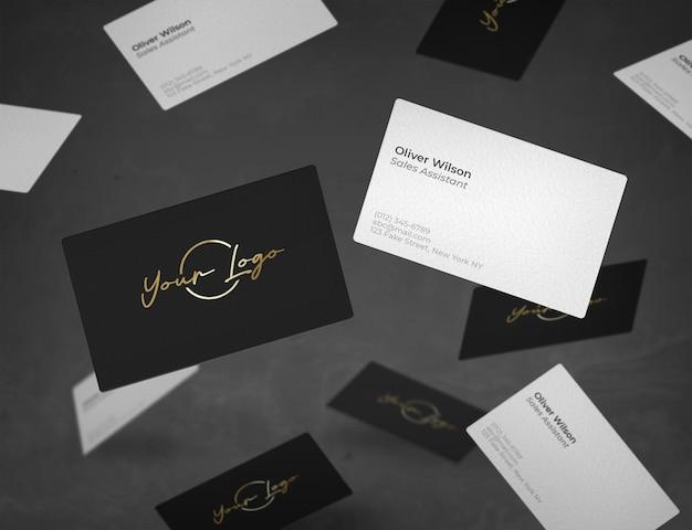 Maqueta de tarjetas de negocios cayendo