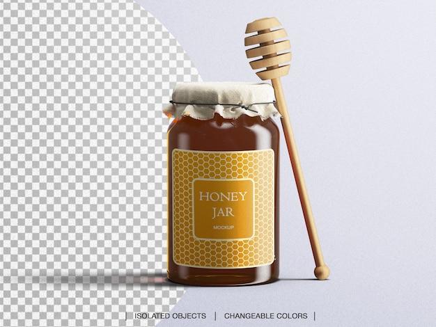 Maqueta de tarro de miel botella de vidrio de embalaje con cuchara de miel aislada