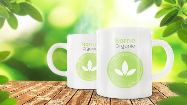 Maqueta de taza de café en frondosas orgánicas