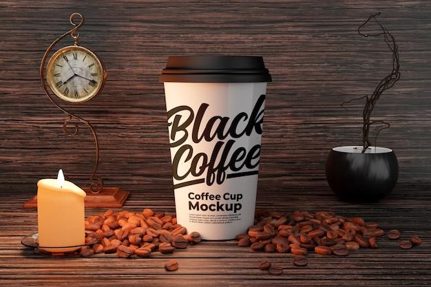 Maqueta de taza de café con leche con decoraciones de velas y granos de café