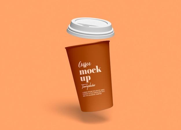 Maqueta de taza de café de papel volador para llevar