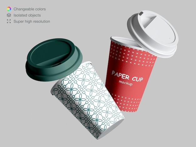 Maqueta de tazas de café flotante realista con tapas