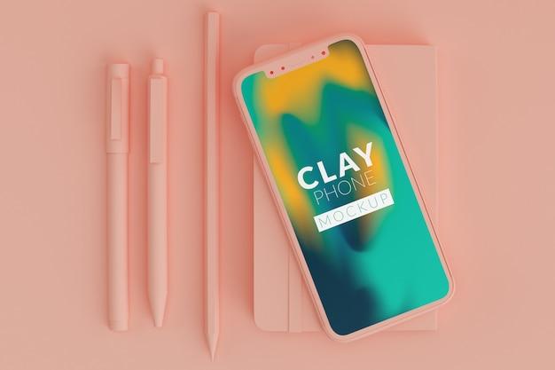 Maqueta de teléfono de arcilla rosa
