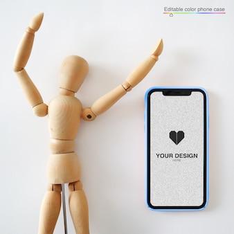 Maqueta de teléfono inteligente con muñeco de madera