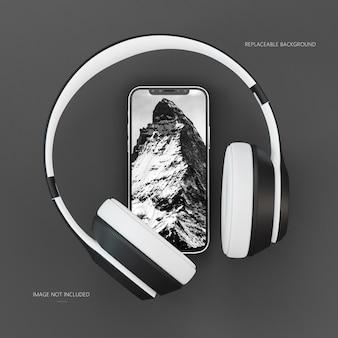 Maqueta de teléfono inteligente con pantalla de dispositivo con auriculares