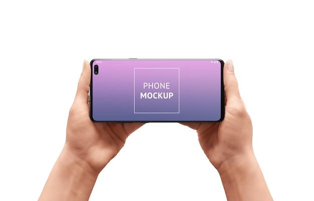 Maqueta de teléfono en manos de mujer. posicion horizontal.