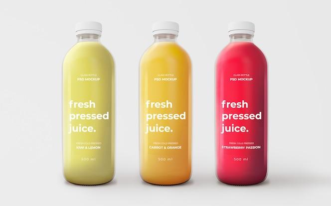 Maqueta totalmente editable con botellas de vidrio de diferentes sabores.