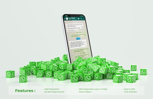 Maqueta de whatsapp en teléfono móvil con pila dispersa de cubos icono whatsapp PSD Premium