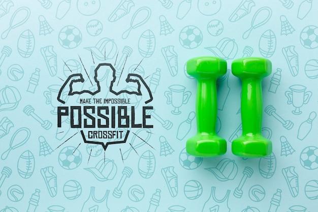 Maquetas de pesas de mano verde para fitness