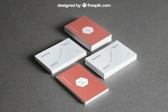 Maquete de papelaria com quatro pilhas de cartões de visita