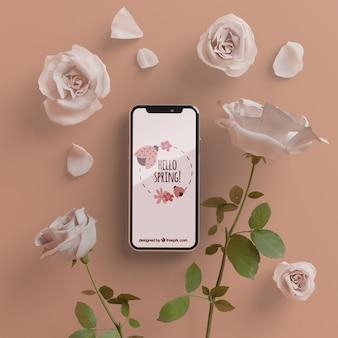 Marco floral con concepto de dispositivo móvil