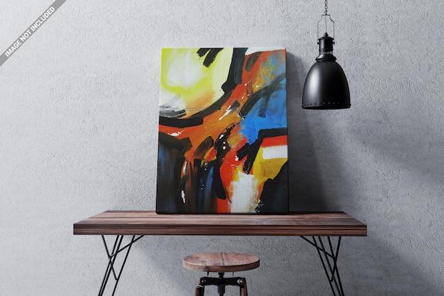 Marco de lienzo de imagen en la maqueta de la mesa