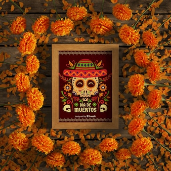 Marco de maqueta de calavera roja rodeada de flores naranjas