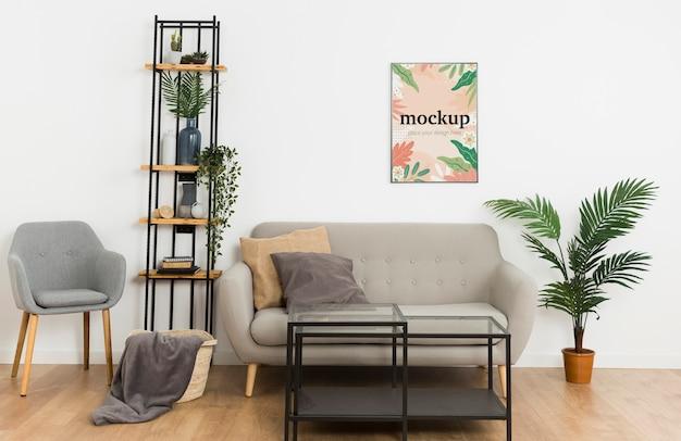 Marco de maqueta de vista frontal en pared blanca en sala de estar