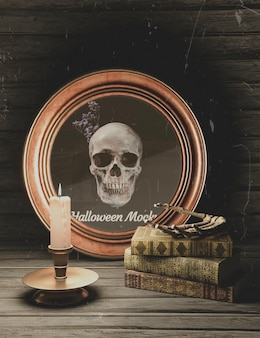 Marco redondo de halloween con calavera y pila de libros