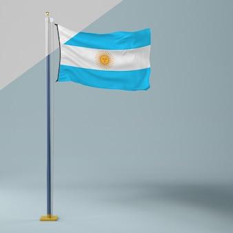 Mástil de bandera con bandera argentina