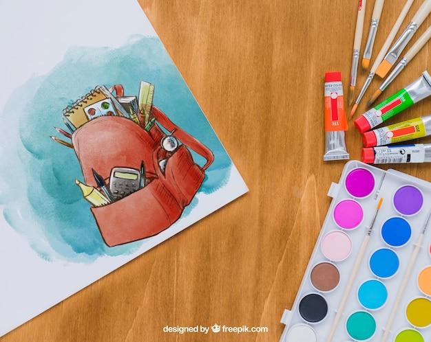Materiales para clase de arte con dibujo en acuarela