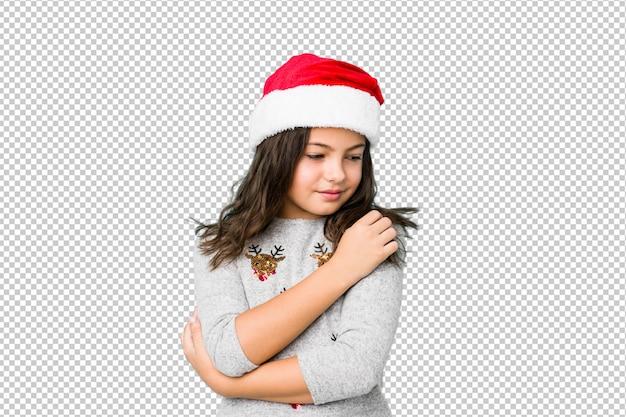 Meisje het vieren de knuffels van de kerstmisdag, onbezorgd en gelukkig glimlachen.