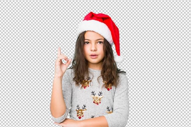 Meisje het vieren kerstmisdag die één of ander groot idee, concept creativiteit hebben.