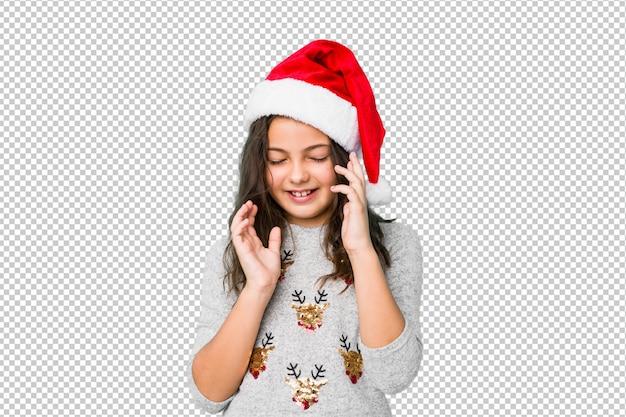 Meisje het vieren kerstmisdag vreugdevol veel lachen. geluk concept.