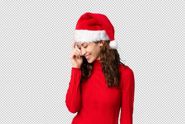 Meisje met kerstmishoed het lachen