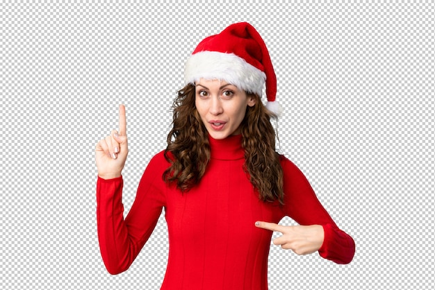 Meisje met kerstmishoed met verrassingsgelaatsuitdrukking