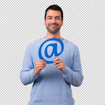 Mens met het blauwe pictogram van de sweaterholding van bij puntcom