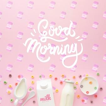 Mensaje de buenos días en la mesa y leche con cereales