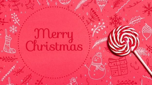 Merry christmas achtergrond met doodle en lolly