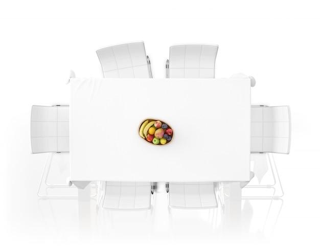 Mesa con mantel, frutas y sillas.